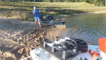 Aeration equipment being prepared for installation on a small private lake that is being stocked with fish.