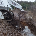 Small equipment can be used to create swales that keep run-off water from directly entering the pond that contains excessive nutrients and organic material.